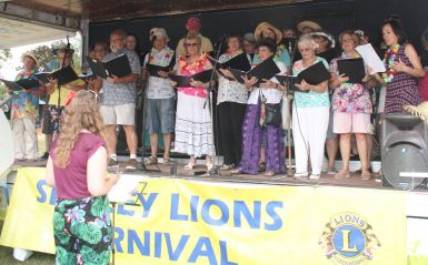 Shirley Community Gospel entertain the crowd with some summery songs